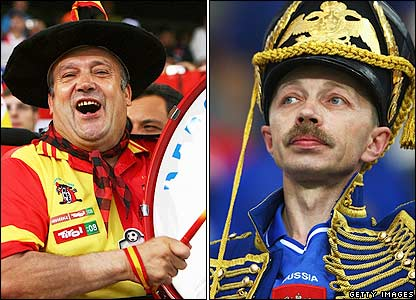 A Spain and a Russia fan show off their costumes
