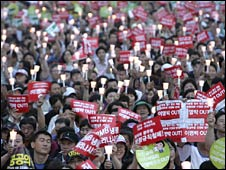 Candle-bearing protesters demand the resignation of President Lee Myung-bak in Seoul, South Korea, on Tuesday