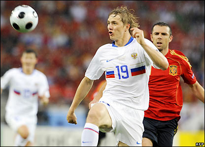 Pavlyuchenko looks to take control of the ball