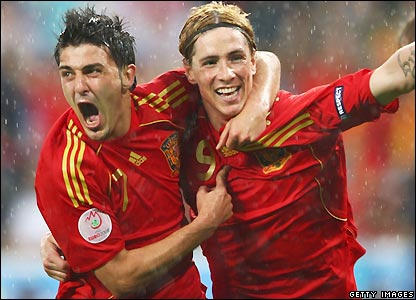 Villa and Torres celebrate the opening goal
