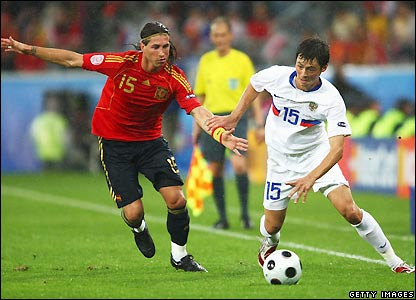 Sergio Ramos and Diniyar Bilyaletdinov in action