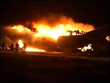 Video still of plane on fire