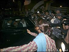 A supporter of the monarchy tries to block Gyanendra's car