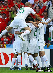 Deco is mobbed by his team-mates after giving the Portuguese an eighth-minute lead