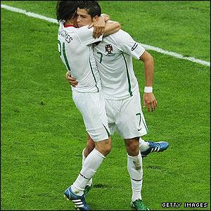 Nuno Gomes congratulates his Portuguese team-mate Cristiano Ronaldo