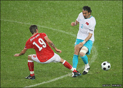 Valon Behrami of Switzerland challenges Servet Cetin