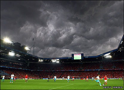 An angry looking sky looms over the stadium