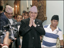 Nepal's former King Gyanendra greets people after addressing a press conference at the Narayanhiti palace in Kathmandu