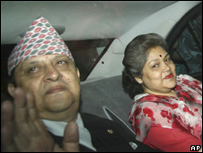 Nepal's deposed King Gyanendra, left, and Queen Komal, leave the Narayanhiti palace in Kathmandu