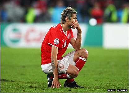 Swiss players, including Valon Behrami are left devastated