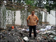 Ma Yuanyou, in the rubble of his house