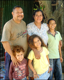 Ozario and Lily and three of their seven children