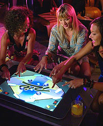 Women use touchscreen table