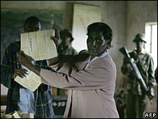 A polling officer shows a marked ballot in Oronkai, western Kenya, 11 June 2008