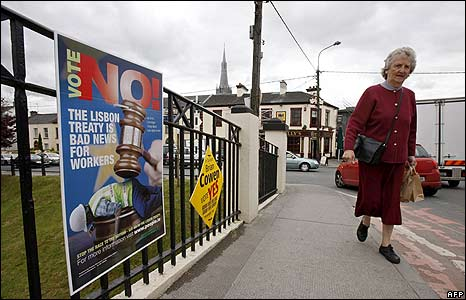 A woman passes No and Yes campaign posters in Mullingar, Irish Republic, on 12 June