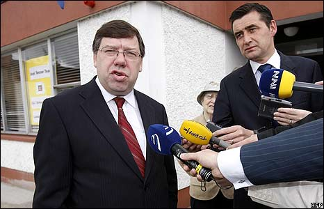 Irish Prime Minister Brian Cowen talks to reporters in Mullingar, Republic of Ireland, on polling day