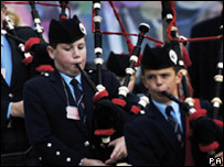 Pipers in the Riding procession walk down the Royal Mile (Pic: PA)