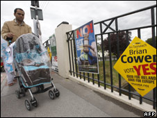 A man walks past campaign placards in Mullingar, Ireland (12/06/08)