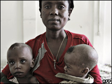 A woman with her two malnourished sons in a feeding centre in Shanto, Ethiopia (8 June 2008)