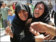 Relatives of those killed in the Beit Lahiya blast (12 June 2008)