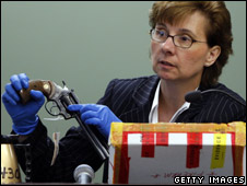 Police Sergeant Mary Ritchie holds the murder weapon
