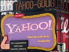 A news ticker carries headlines about Yahoo and Google above a Yahoo billboard on 17 April, 2008 in New York's Times Square