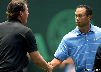 Phil Mickelson (left) and Tiger Woods shake hands after the opening day at Torrey Pines