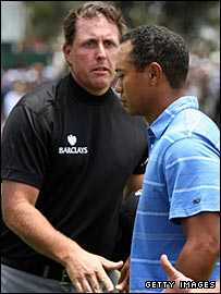 Phil Mickelson (left) and Tiger Woods
