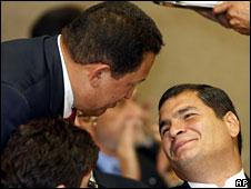 Hugo Chavez, left, talks to Rafael Correa, 23 May 2008