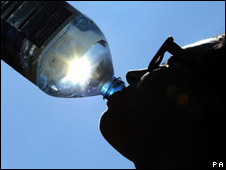 Girl drinks bottled water