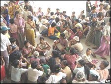 Residents wait for free rice from the government following devastating cyclone Nargis in Burma, May 8, 2008.