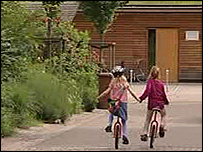Children cycling down a street in Vauban