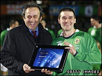 Michel Platini presents a goalscoring award to David Healy