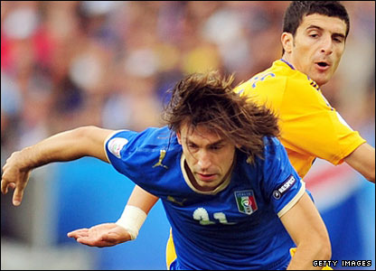 Andrea Pirlo holds off Daniel Niculae