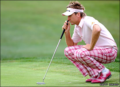 England's IanPoulter lines up a putt at the first hole