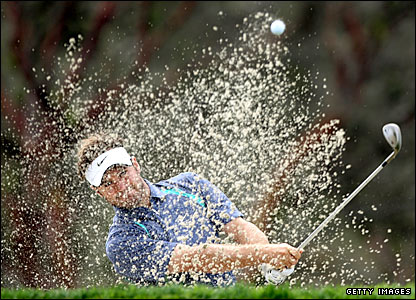 Trevor Immelman plays a shot out of the bunker