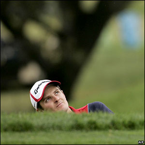Justin Rose tries to get out of a bunker