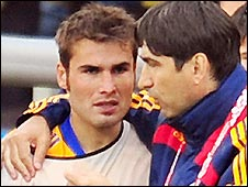 Romania boss Victor Piturca (right) consoles Adrian Mutu after the draw with Italy