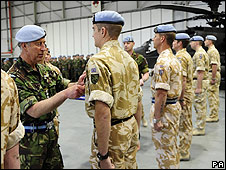 Prince Charles gives medals to soldiers