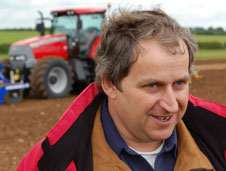 Farmer Brian Hammond in a field with his tractor