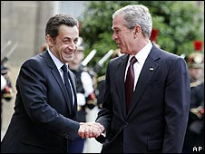 U.S. President George W. Bush, right, is welcomed by French President Nicolas Sarkozy for a dinner at the Elysee Palace in Paris