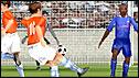 Wesley Sneijder scores the Netherlands' fourth against France