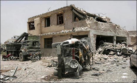 Mangled vehicle in front of prison in Kandahar, 14 June