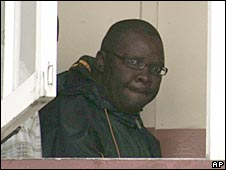 Tendai Biti seen through the window of a courthouse in Harare, 14 June 2008