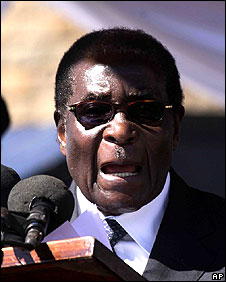 President Robert Mugabe at the burial of Norbert Chingombe in Harare.