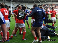 Wales and France players scuffle at the end of their IRB Junior World Championship pool game