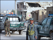 An Afghan policeman in front of the Kandahar prison, 14 June