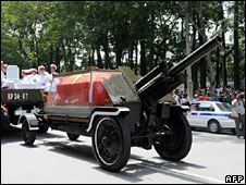 Vo Van Kiet's coffin is transported in a glass case through Ho Chi Minh City