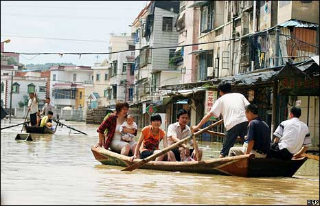 Residents of Zhangzhou town, in China's Fujian province, make their way by boat, 14 June