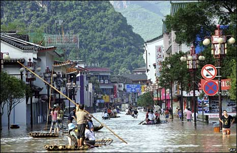 People use rafts to navigate the streets in Yangshuo county, Guangxi Zhuang Autonomous Region, 14 June